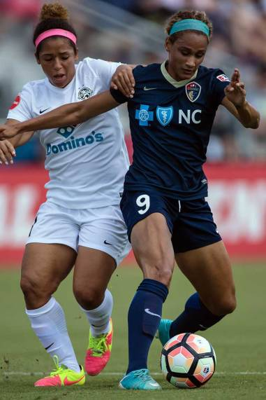 FC Kansas City's Desiree Scott and North Carolina Courage's Lynn Williams. (Shane Lardinois)
