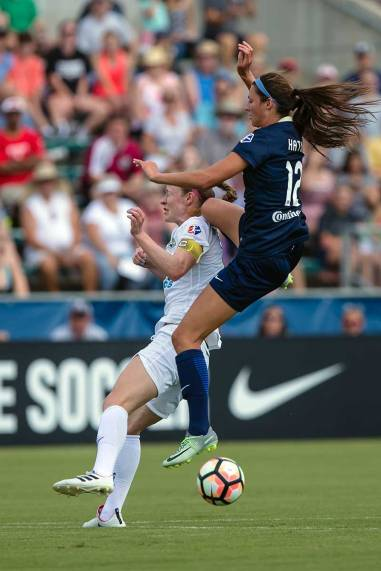 Ashley Hatch, uh, misjudges a challenges on Becky Sauerbrunn. (Shane Lardinois)