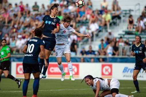 Abby Erceg heads the ball toward goal. (Shane Lardinois)