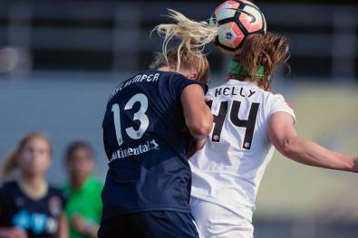 Abby Dahlkemper and Maegan Kelly vie for the ball. (Shane Lardinois)