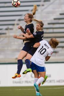 Captain Comma gets up for the ball. Sam Mewis heads the ball over teammate McCall Zerboni and Boston Breaker Rosie White. (Shane Lardinois)