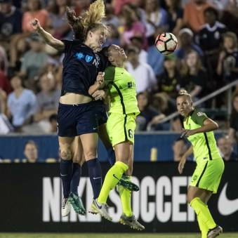 Sam Mewis and Lindsay Elston in an air battle. (Shane Lardinois)