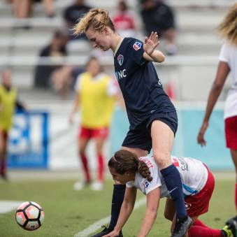 When a game of Twister breaks out at a soccer match. Sam Mewis and Danny Colaprico. (Shane Lardinois)
