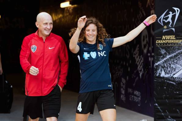 Paul Riley, head coach of the North Carolina Courage, and Elizabeth Eddy walking out for pregame warm-ups at the 2017 NWSL Championship. (Monica Simoes)