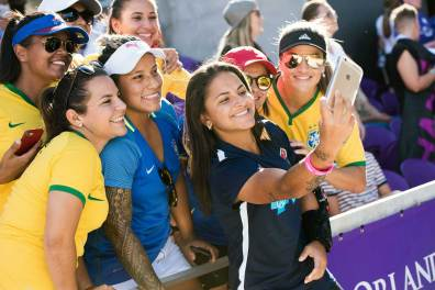 Debinha of the North Carolina Courage taking selfies with fans at the 2017 NWSL Championship. (Monica Simoes)