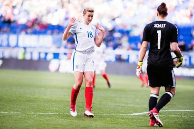 England's Ellen White says hello to Germany's Almuth Schult. (Monica Simoes)