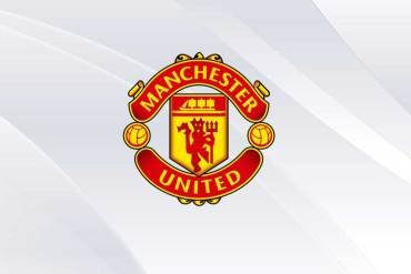 Manchester United logo on white background.