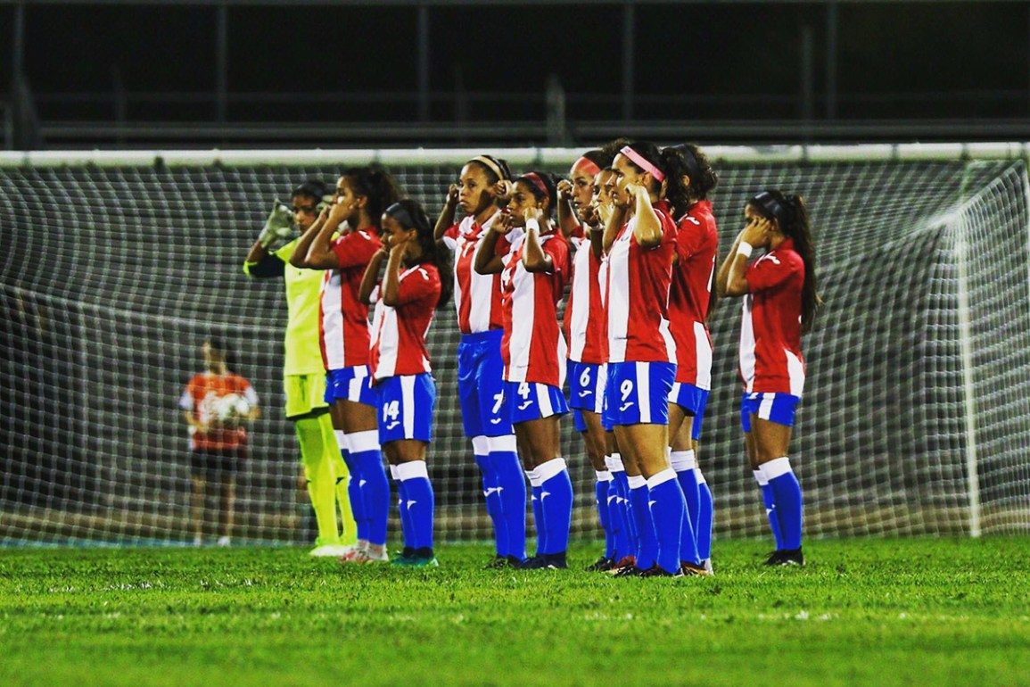 Members of the Puerto Rico Women's National Team silently protest against subpar treatment during a friendly against Argentina. (Nicole Rodriguez)