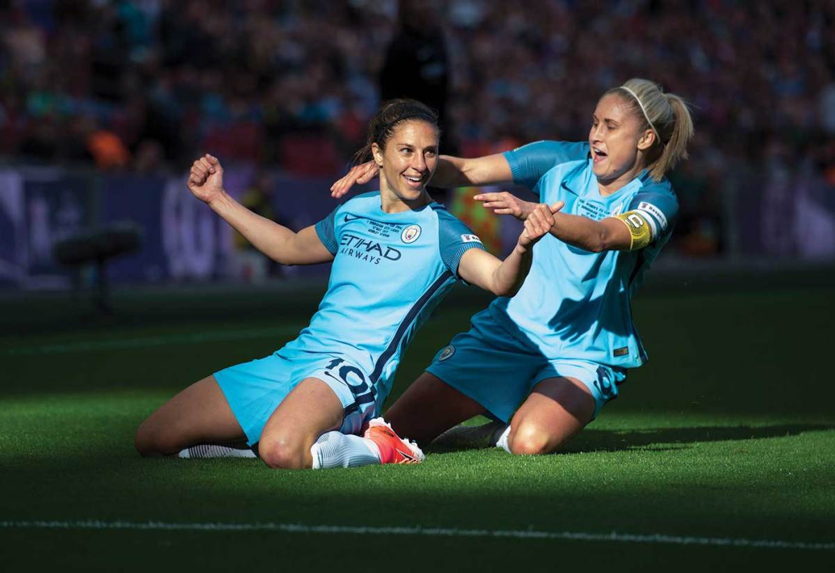 Carli Lloyd celebrating a goal while playing in Champions League with Manchester City. (Brad Smith/ISI)