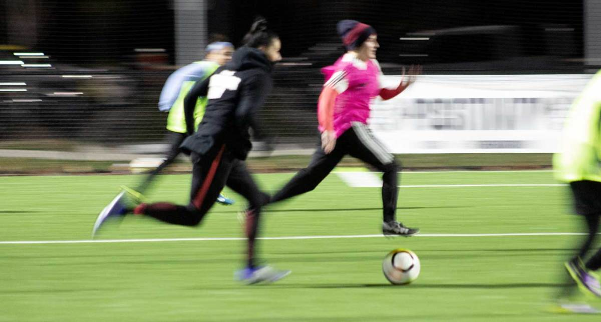Ali Krieger playing at her AKFC Adult Camp in a motion blur.