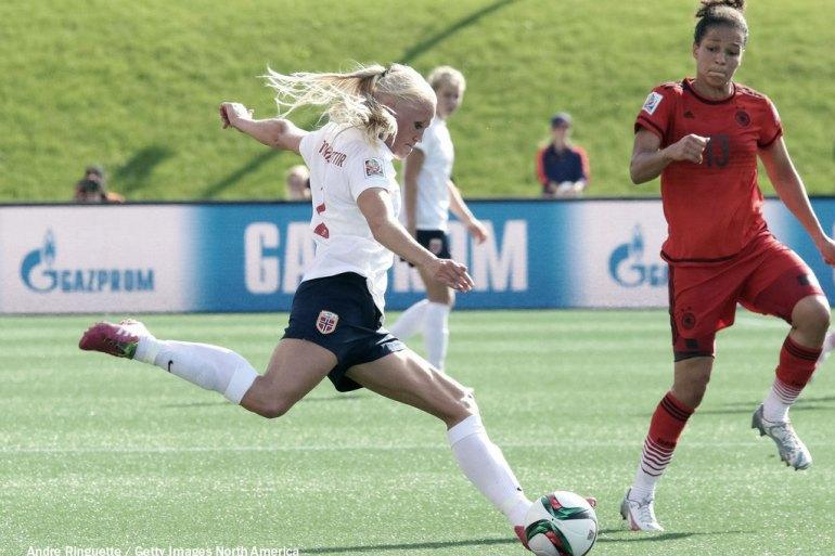 Norway's Maria Thorisdottir takes on Germany's Celia Sasic. (Andre Ringuette / Getty Images North America)