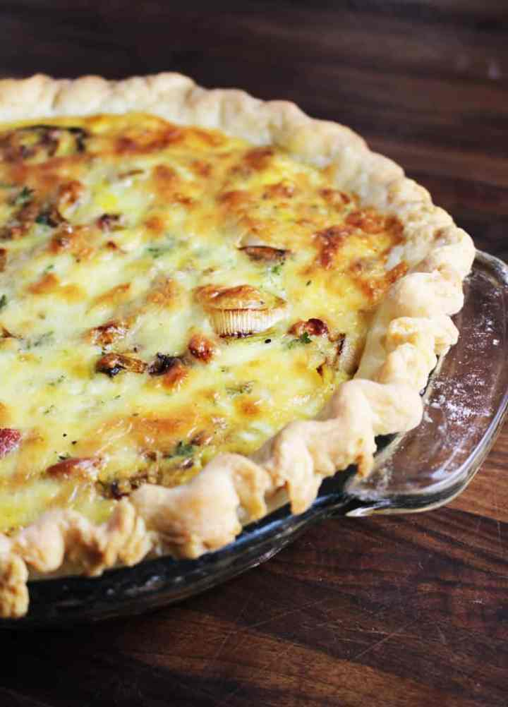 This easy spring leek and bacon quiche is a family favorite, and is perfect for any meal from breakfast to dinner.