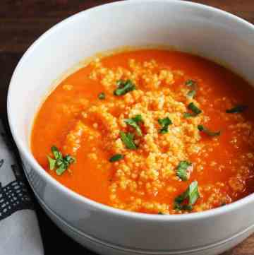 This beautiful, bold soup gets a ton of flavor from harissa, and is extra satisfying on a chilly fall evening with the amazing addition of a couscous swirl.