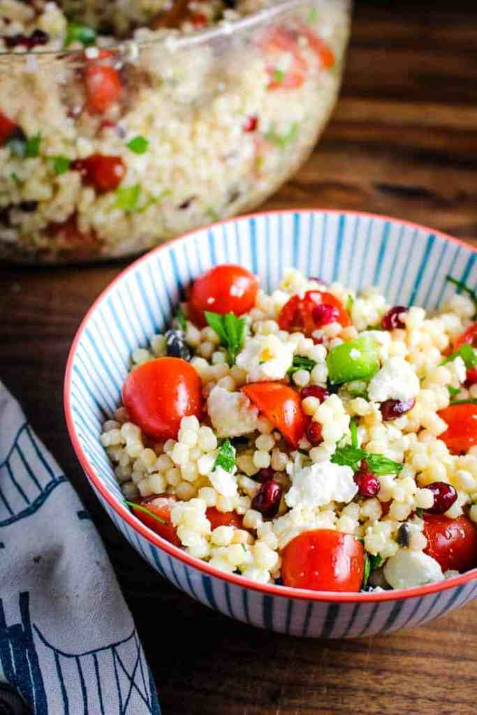A bowl of Israeli couscous salad