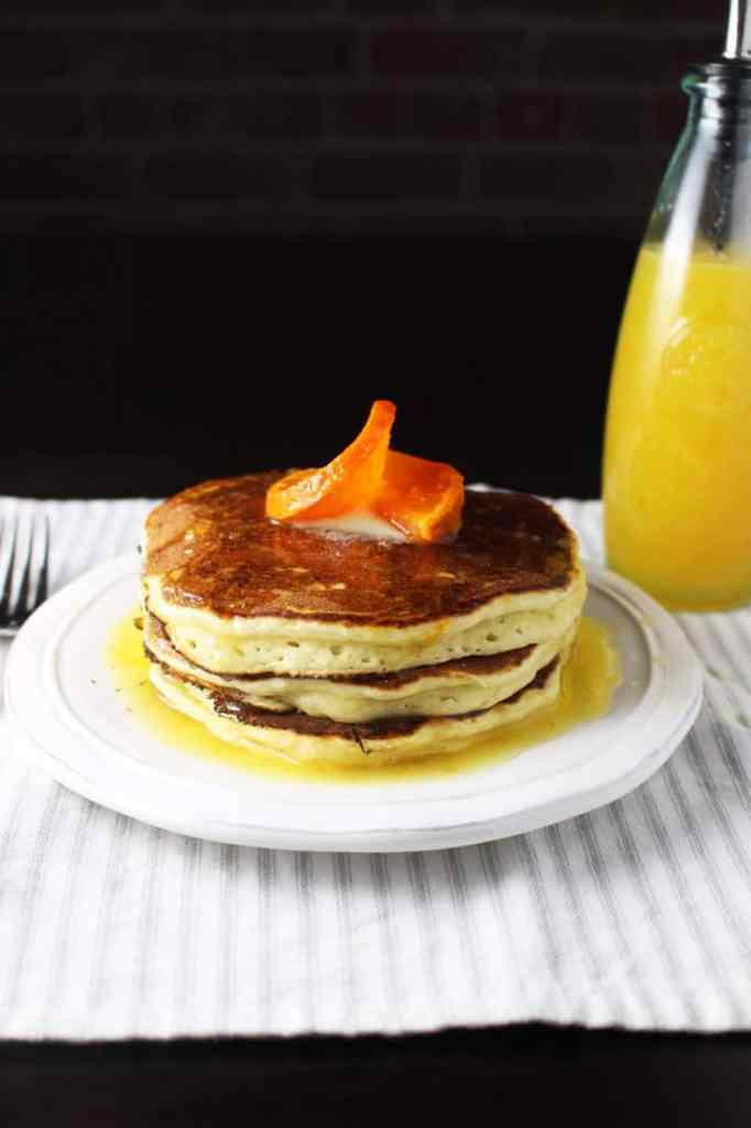 A stack of ricotta pancakes on a plate