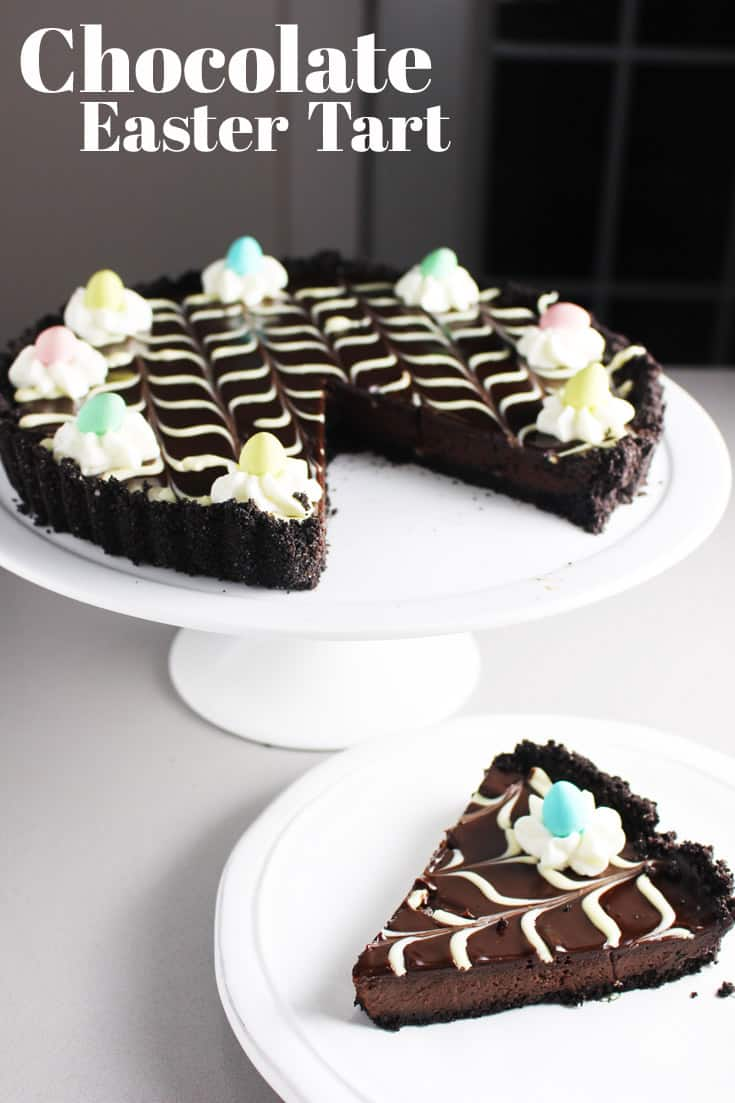 This chocolate tart recipe has a buttery chocolate wafer crust and a dark and dreamy silky chocolate filling. It's a festive and sophisticated dessert that is  surprisingly easy to make and decorate! #Easter #Eastereggs #chocolate #chocolaterecipes