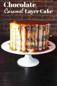 Three layer chocolate caramel cake, drizzled with caramel, on a cake stand