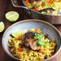 One pot Cuban chicken and rice in a shallow bowl