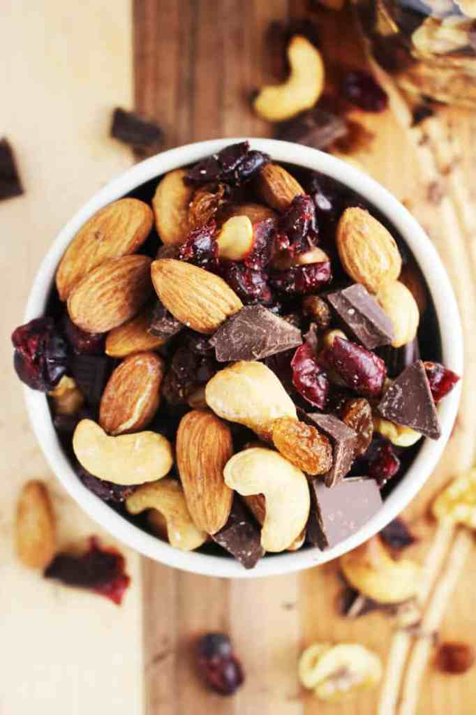 healthy trail mix in a bowl on a wooden cutting board