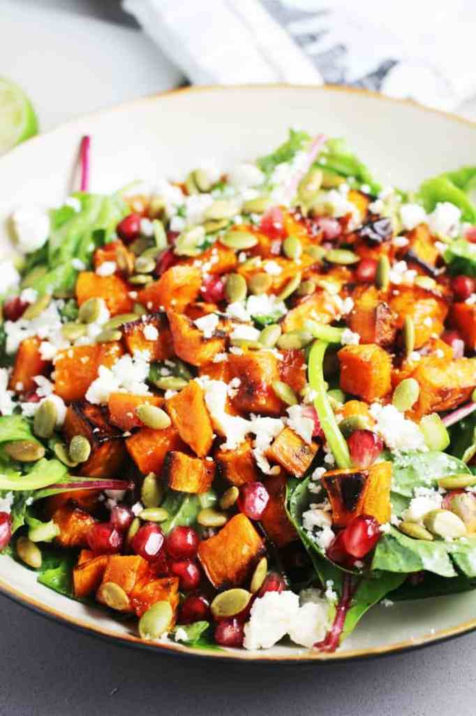 A bowl of roasted sweet potato salad with kale