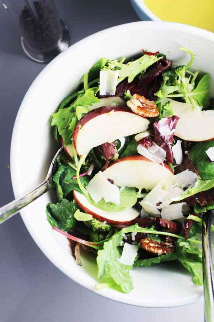 Fall salad with apples and maple dressing in a large salad bowl