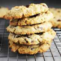 A stack of oatmeal chocolate chip cookies with peanut butter on a cooling rack