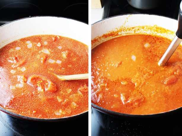 Tomato soup cooking in a dutch oven, and being blended with an immersion blender