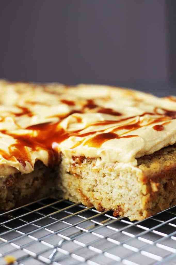 Banana caramel cake with caramel frosting, drizzled with caramel