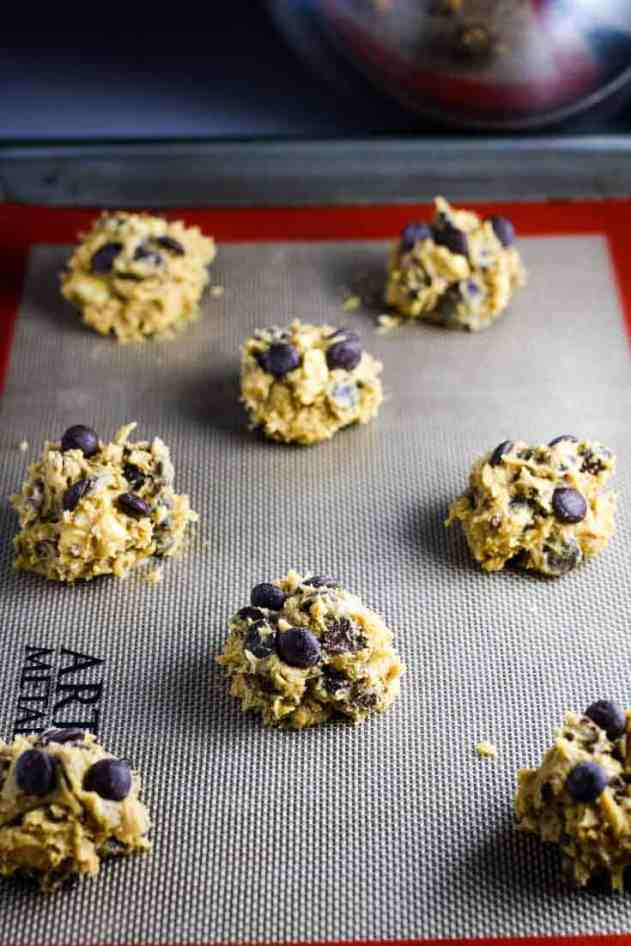 balls of chocolate chip cookie dough on a baking sheet