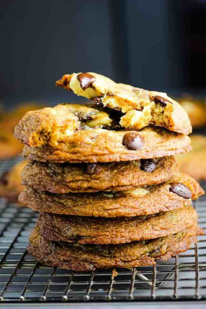 A stack of chocolate chip cookies on a wire rack