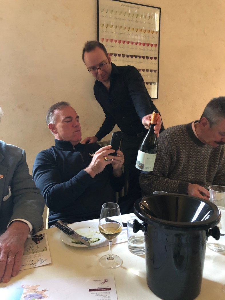 Chris serving wine to a Chevalier at Emma Kershaw's Maison du Rire Carcassonne Wine Excursions