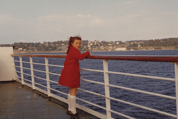 1972-MS-Victoria-Vibeke-in-a-red-coat-Norwegian-Constitution-Day