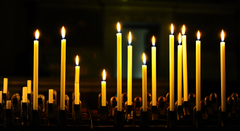 Burning Candles Before The Altar In The Church