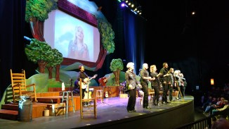 Family and some friends of Dolly Parton perform at Dollywood several times a day with her video image