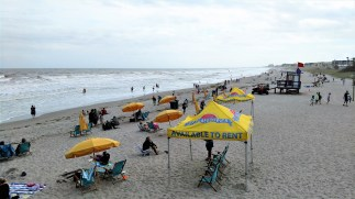 Beach goers on the sands of Cocoa Beach, Florida - about 75 degrees and 15-20 MPH winds