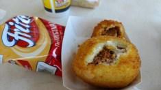 Broacatos potato ball (larger) and crab cake (smaller)