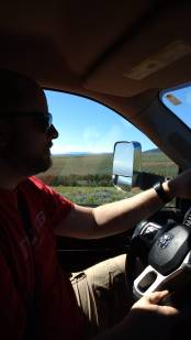 """As we continued along the """"off-roading"""" on the road, Jason has a firm grip of the wheel as there were a number of locations where there were no guard rails over some steep cliffs"""