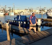 """Captain Shaw in front of their new boat, capable of going through only 1"""" of water, with http://bayoubadboysbowfishing.com/ in the bayou outside of Lafitte, LA"""