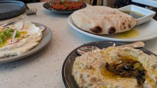 Pitas made in their stone oven are features with the numerous options of humus at Shaya, Magazine Street, New Orleans, LA