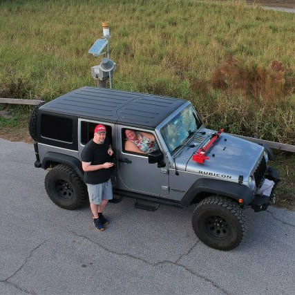 """Photo of Jason, Barb and the 2017 Jeep """"Rubi"""" on the East Coast of Florida New Years day 2021"""