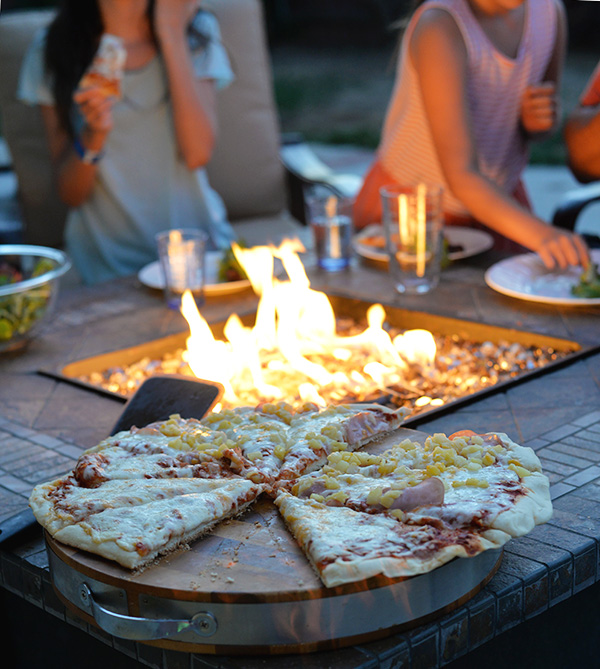 eating grilled pizza outdoors
