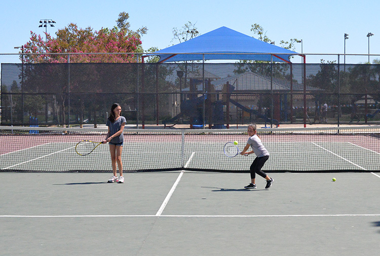 kids practicing tennis