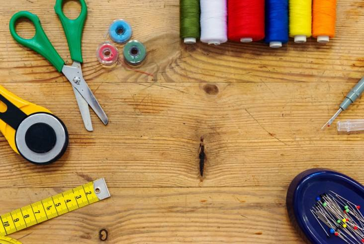 sewing supplies on a wooden background