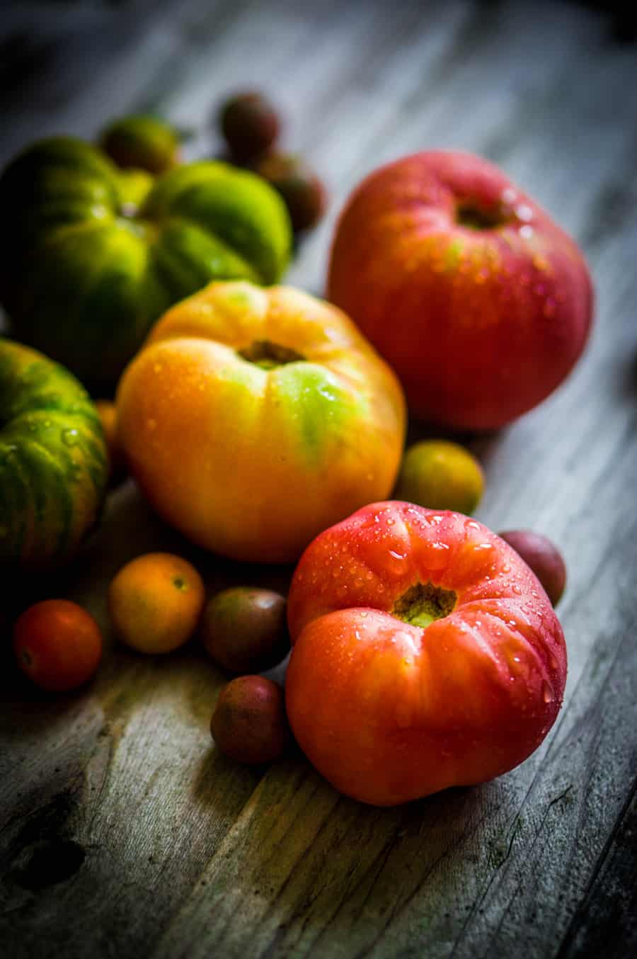 heirloom tomatoes on wooden surface