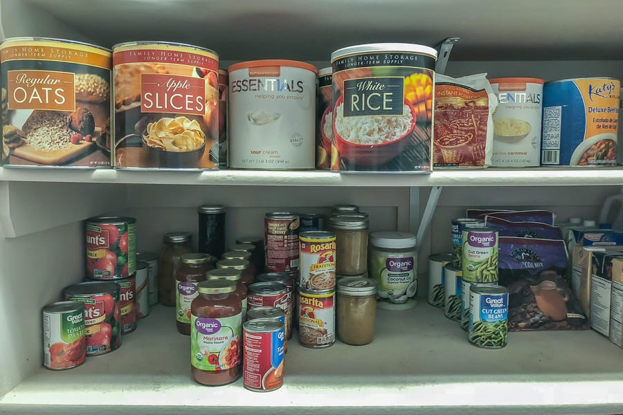 a pantry shelf full of canned food