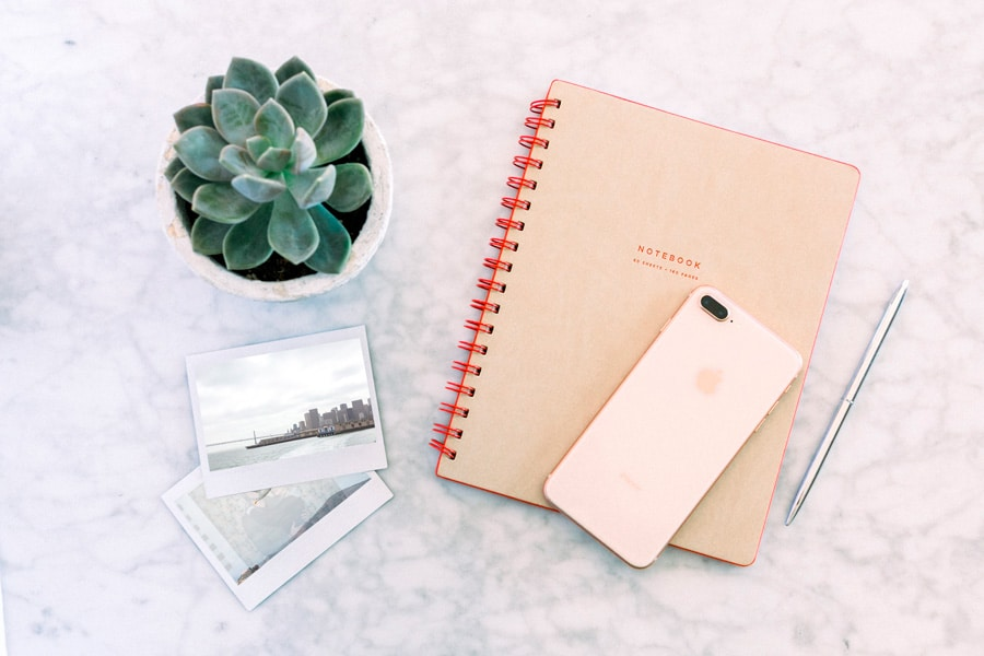 journal and phone on marble background