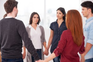 Trust circle. Group of people standing in circle and holding hands