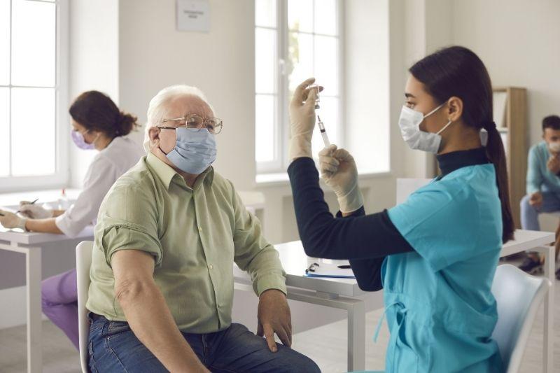 senior taking vaccine