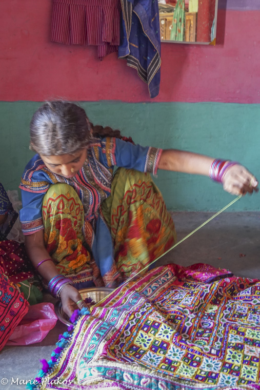 Young girl sewing on her dowry.