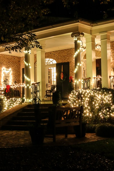 Southern Porch tour full of ideas with plaids and more! #christmas #christmasporch #christmasdecor